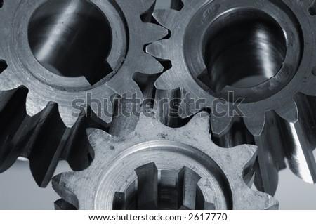 smaller gearbox-gears machinery in a bluish metallic tone - stock photo