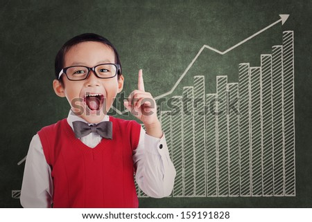 Smart asian student with business chart - stock photo