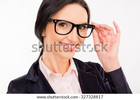 smart beautiful woman in glasses smiling and adjusting her glasses
