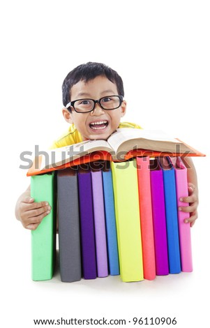 Smart boy smiling with stack of textbooks isolated on white