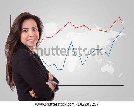 Smart business woman over world map with red and blue graph chart.