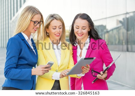 Smart business women looking at tablet