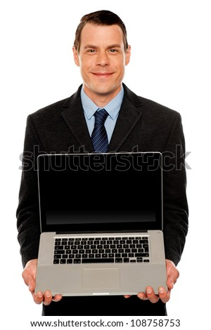 Smart businessman displaying laptop to you. All on white background
