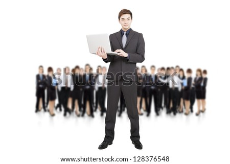 smart businessman holding laptop and successful business team - stock photo