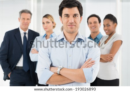 Smart Businessman Standing In Front Of His Colleague - stock photo