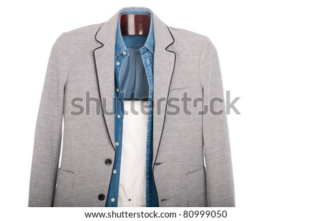 smart casual man dressing for a celebration, event, wedding or night-out on a wooden hanger (shirt, jacket and trousers) isolated on white background