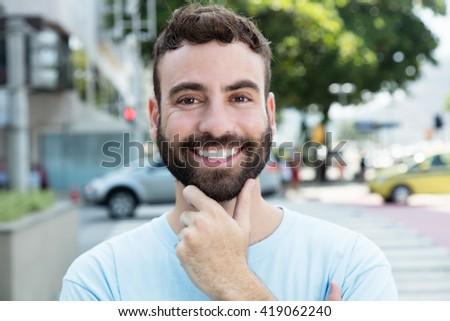 Smart caucasian man with beard outdoor in city - stock photo