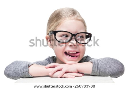 Smart cheerful beautiful little girl in glasses looking on something isolated  - stock photo