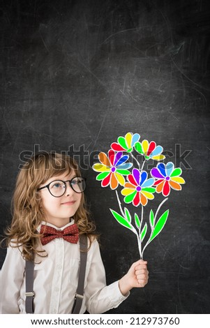 Smart child in class. Happy child against blackboard. Education concept - stock photo