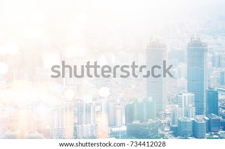 smart construction and financial technology concept. City building with crane abstract background with flare light effect.