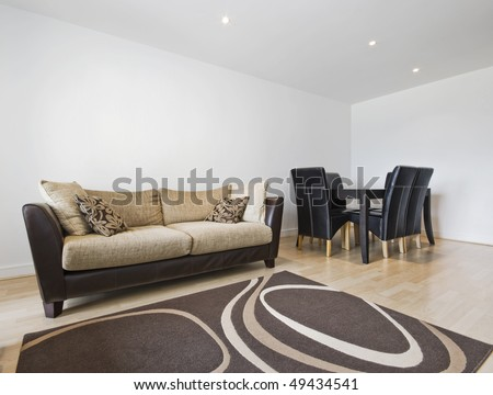 smart contemporary living room with dining table - stock photo