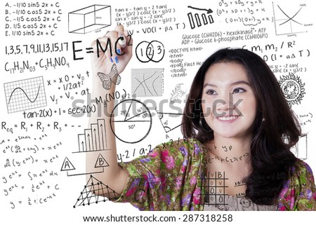 Smart female high school student writing various high school math and science formula - stock photo