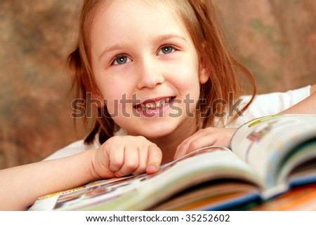 Smart girl reading a book and learns - stock photo