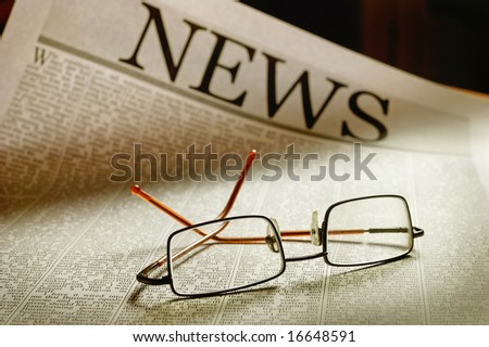 smart glasses on newspaper page - stock photo