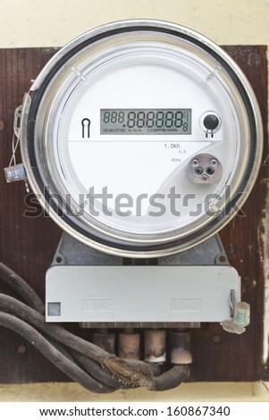 Smart grid residential digital power meter with digital display working - stock photo