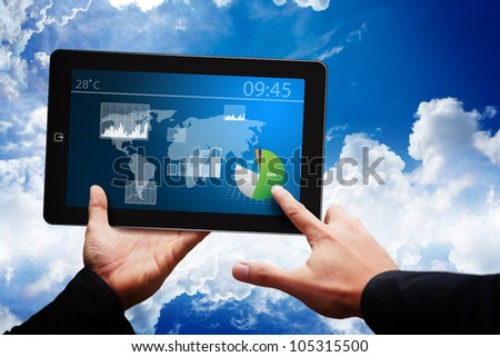 Smart hand and data report on digital touch pad - stock photo
