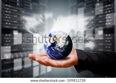 Smart hand hold the world in data center room : Elements of this image furnished by NASA - stock photo