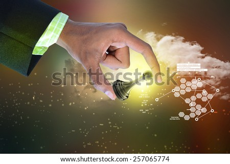 Smart hand holding black pawn  - stock photo