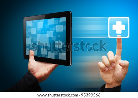 Smart hand press on First Aid icon from tablet pc - stock photo