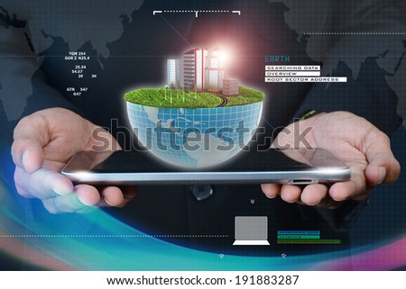 Smart hand showing ecology concept with tablet computer