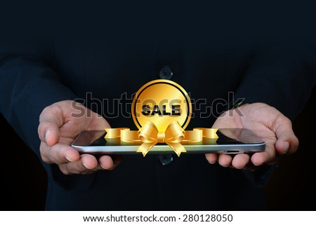 Smart hand showing sale tag - stock photo
