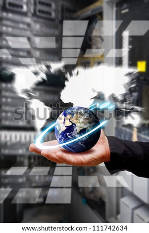 Smart hand take control the digital world in data center room : Elements of this image furnished by NASA - stock photo