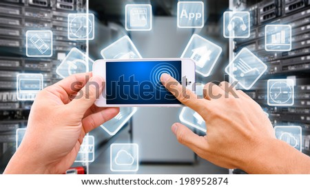 Smart hand touch on smart phone and icon explode - stock photo