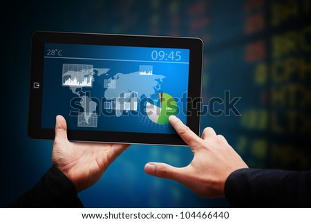 Smart hand touch on touch pad and Graph report - stock photo
