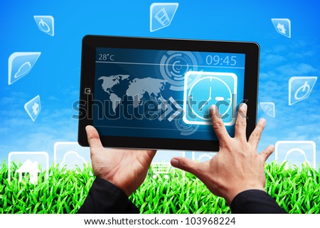 Smart hand touch the Clock icon on tablet pc - stock photo