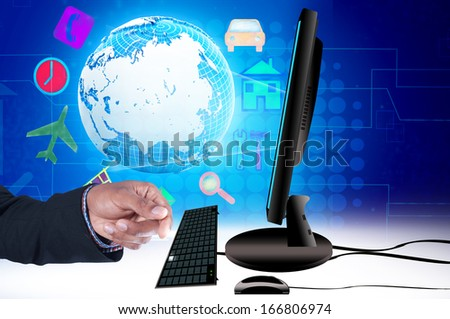 Smart hand with laptop and computer - stock photo