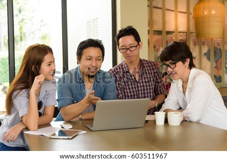 Smart handsome asian businessman explaining his project to asian Team group freelancer in casual suit at coffee shop cafe. Business and Office Concept.