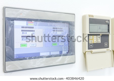 Smart home automation: wall display showing household consumptions related to temperature and heating. - stock photo