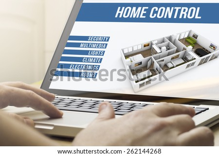 smart home concept: man using a laptop with house automation software on the screen - stock photo