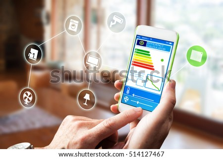 Smart home, intelligent house automation remote control technology concept on smart phone / tablet working with smarthome app. IOT - internet of things
