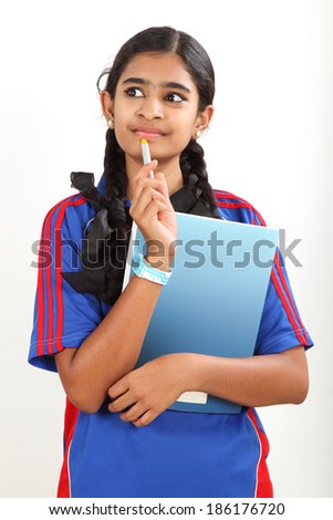 Smart Indian student getting an idea. isolated on white background - stock photo