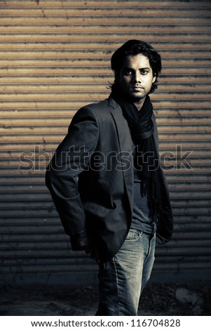 Smart Indian young man posing to the camera. - stock photo