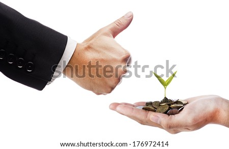 Smart Investment concept- Hand like and hand with seed and coins over white background - stock photo