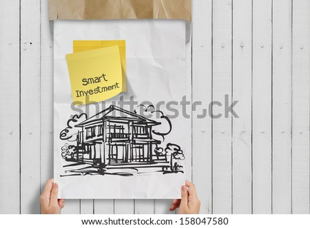 smart investment  sticky note with house crumpled envelope paper as concept - stock photo