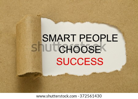Smart people Choose Success word under torn paper - stock photo