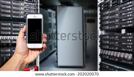 Smart phone and data center room  - stock photo