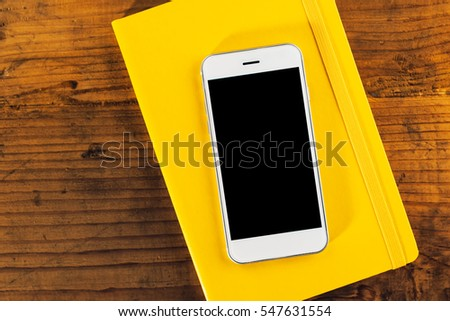 Smart phone and notebook, business office desk top view mock up copy space