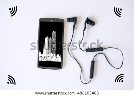 Smart Phone and Wireless earphones or earbuds with wifi signal on white background -  Selective focus