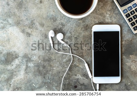Smart phone ,coffee cup and calculator on concrete table - stock photo