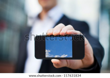 smart phone in the hand of businessman - stock photo