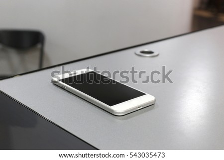 Smart phone lies at the reception