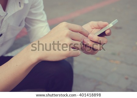 Smart phone messaging:close up people play cellular mobile device for working/relax concept:teenage use mobile device for checking email/appointment/read news/social media network:behavior of people - stock photo
