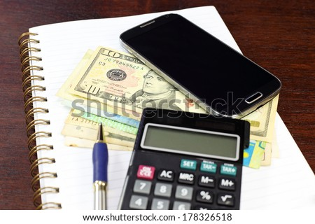 smart phone money business composition on wood table - stock photo