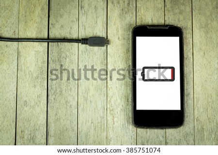Smart phone need to charge battery - stock photo
