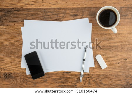 Smart Phone, paper, Eraser and Mechanical pencil with cup of  coffee