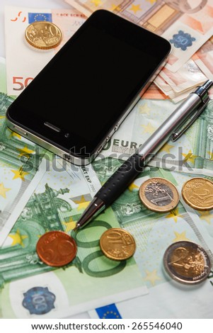 Smart phone, pen and euros - stock photo